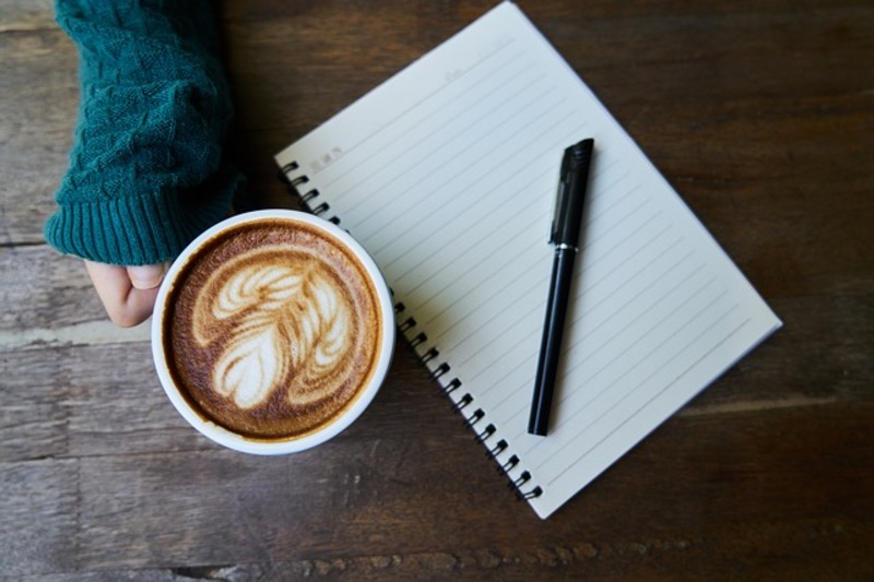 coffee and notebook  - Poets & Writers