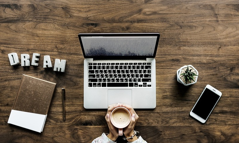 wood desk, laptop, book, phone, cup
